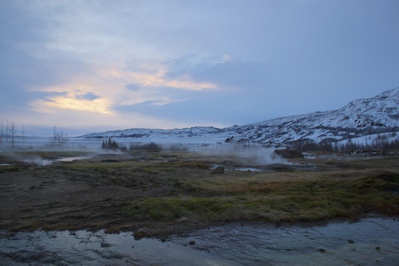 Geysir Geothermal Field in Iceland - Sunset Over Mountains
