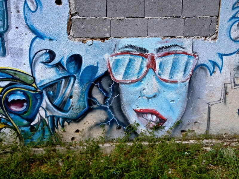 Street Art and Graffiti in Mostar, Bosnia - Woman With Sunglasses
