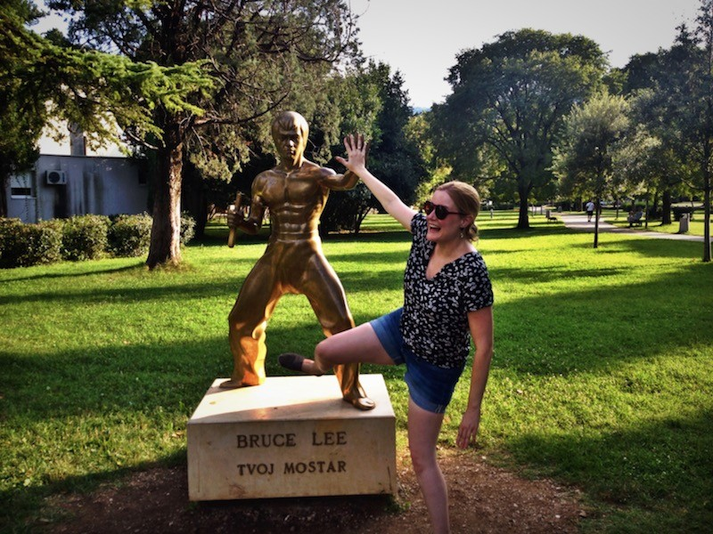 Tourist with Bruce Lee Statue in Mostar