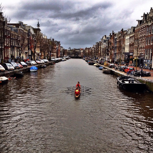 Amsterdam Photos Rowboating Along the Canals in Amsterdam