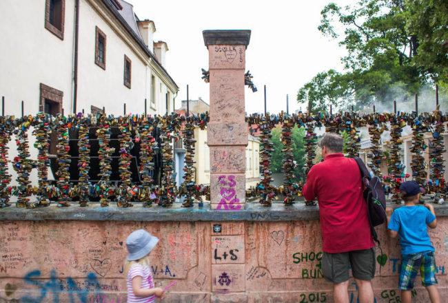 Prague Love Locks Čertovka Bridge- People Looking at Locks