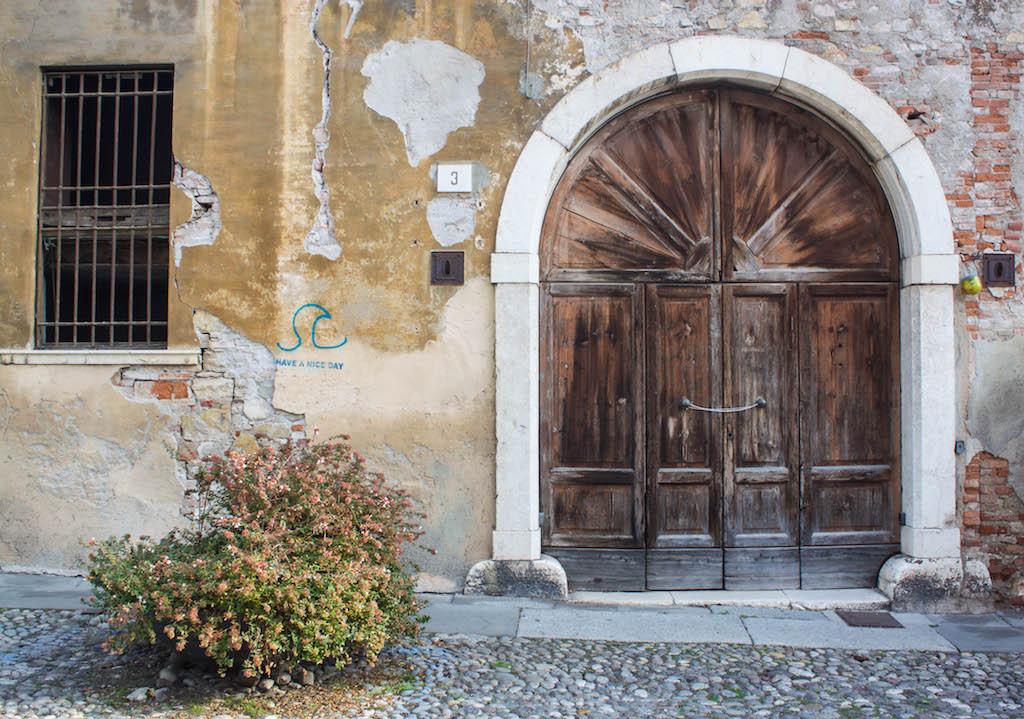 Streets of Brescia - Old Door and Sweet Saying