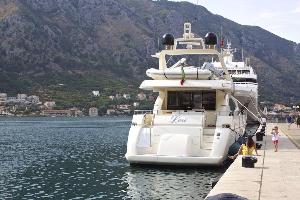 Kotor Montenegro - Yacht and Posing Tourists