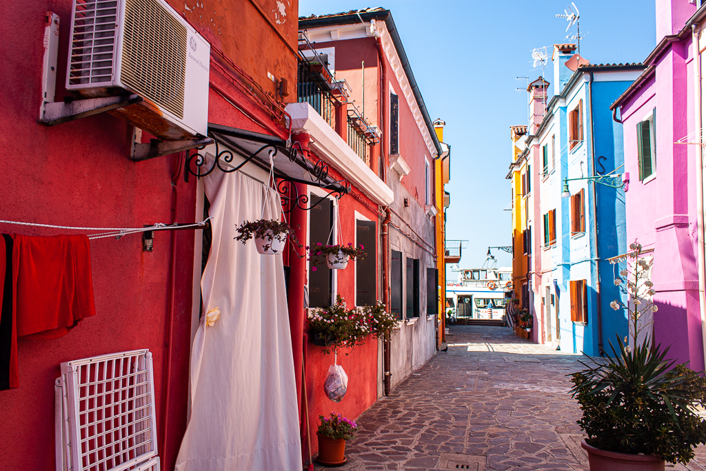 Visit Burano Italy - Streets Clothes Plants